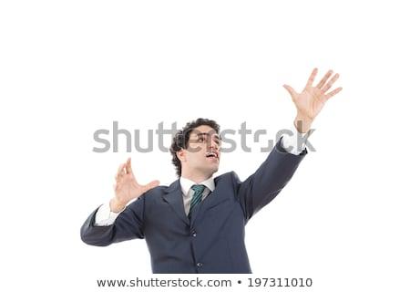 businessman touching something imaginary Stock photo © dolgachov