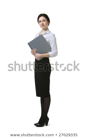 serious young business woman holding folders stock photo © deandrobot