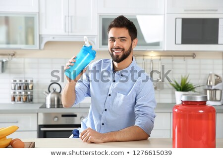 Homem proteína garrafa verão beber Foto stock © Jasminko
