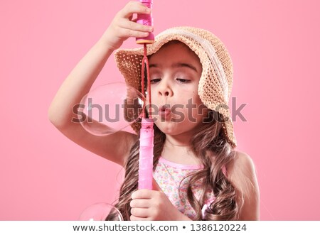 portrait of little girl with bubbles stock photo © phbcz