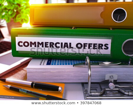 Red Ring Binder with Inscription Commercial Offers. Stock photo © tashatuvango
