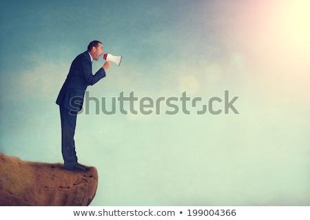 bullhorn businessman megaphone profile shouting stock photo © lunamarina