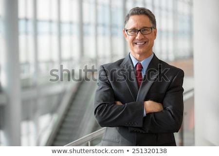 idős · férfi · épület · mosolyog · öltöny · szemüveg - stock fotó © paha_l