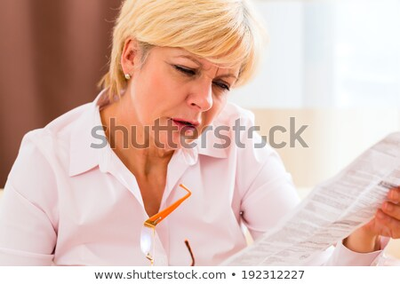 Senior reading with presbyopia package insert Stock photo © Kzenon