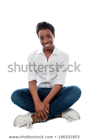 model in black posing seated with hand on waist stock photo © feedough