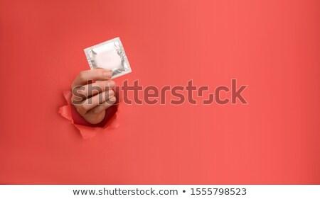 Kırmızı prezervatif tablo bakım güvenlik erkek Stok fotoğraf © racoolstudio