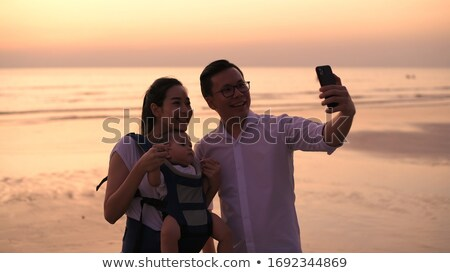 Summer vacation woman beach babe taking selfie Stock photo © Maridav