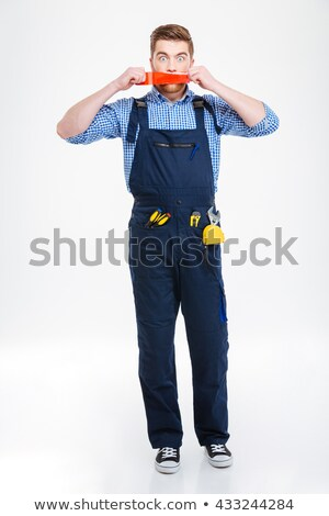 Shocked worker in overall with mouth covered by adhesive tape Stock photo © deandrobot