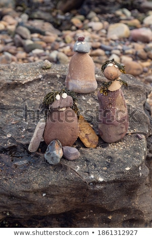 Foto d'archivio: Pebbles Stack And Figurines Of Construction