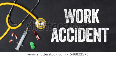 stethoscope and pharmaceuticals on a blackboard   work accident stock photo © zerbor