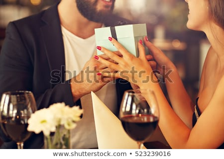 Happy young man gifting a ring to a beautiful young woman  Stock photo © konradbak