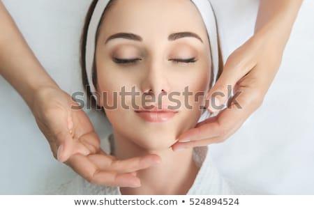 face massage close up of a beautiful woman getting spa treatmen stock photo © yatsenko
