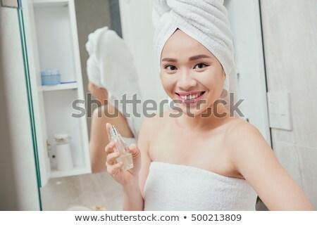 perfume · banheiro · espelho · mãos · mulheres - foto stock © deandrobot