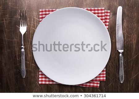 Place setting of a dining set over rustic background Stock photo © StephanieFrey