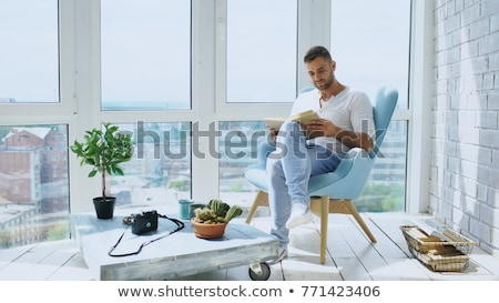 Man reading book and drinking coffee Stock photo © stevanovicigor