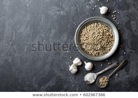 Blanco pimienta ajo sal gris oscuro culinario Foto stock © yelenayemchuk