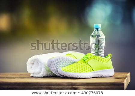 Zapatillas toalla mesa de madera fitness salud Foto stock © wavebreak_media