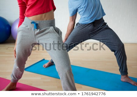 Low section of male instructor exercising with female student in club Stock photo © wavebreak_media