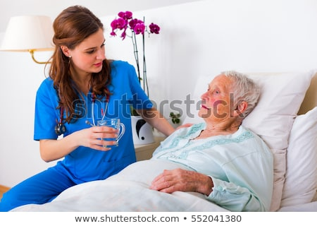 A nurse bringing medication to a patient Stock photo © IS2
