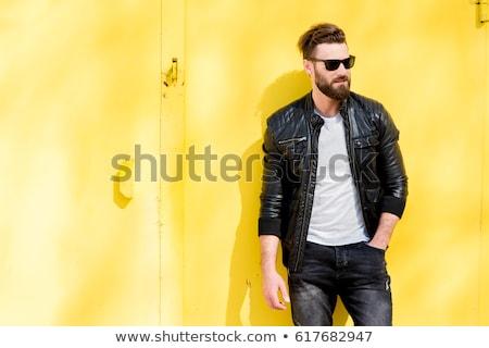 Retrato moço jaqueta de couro óculos de sol Foto stock © deandrobot