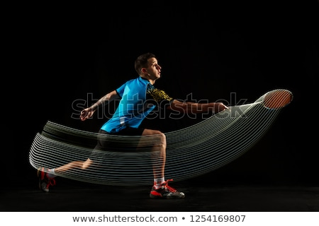 Young man with badminton racket Stock photo © IS2