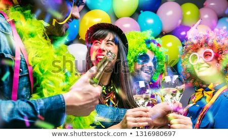 Girls at Carnival parade clinking glasses with champagne stock photo © Kzenon