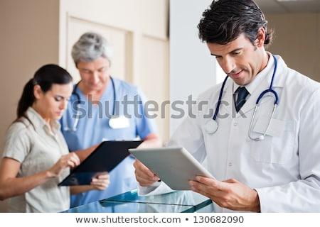 улыбаясь · врач · стороны · подбородок · мышления · больницу - Сток-фото © jasminko