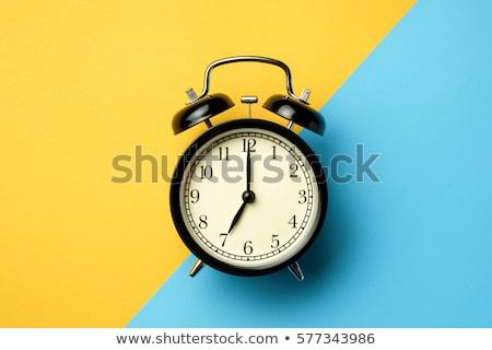 Kettő színes riasztó órák fehér délután Stock fotó © Nobilior
