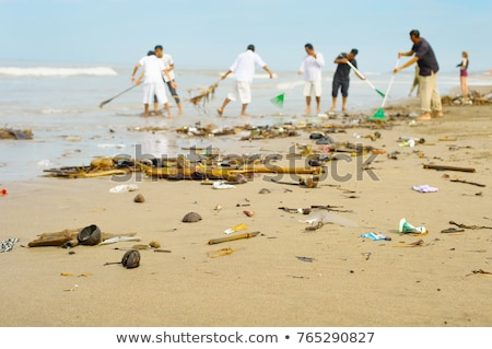 People cleaning polluted beach. Bali Stock photo © joyr