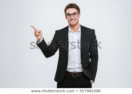 portrait of a happy businessman pointing finger away stock photo © deandrobot