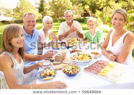 Nő unokák piknik asztal férfi gyermek jókedv Stock fotó © IS2