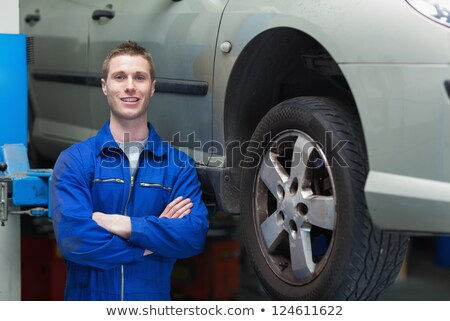Mechanic standing in garage stock photo © monkey_business