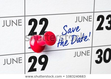 wall calendar with a red pin   june 22 stock photo © zerbor