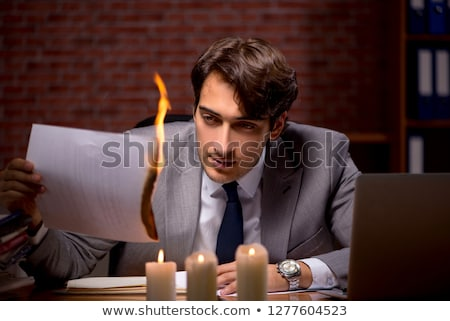 businessman burning the evidence late in office stock photo © elnur