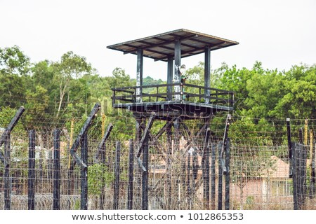 Watch tower at the Prison in the tropics. In the tower is the caretaker's dummy Stock photo © galitskaya