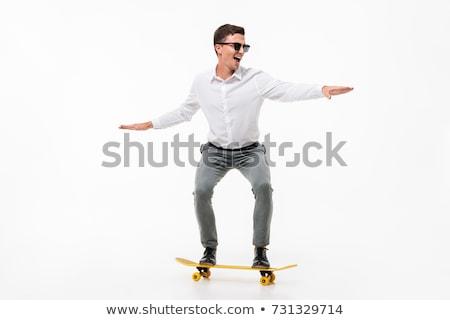 man · skateboard · toevallig · Blauw · tshirt - stockfoto © dolgachov
