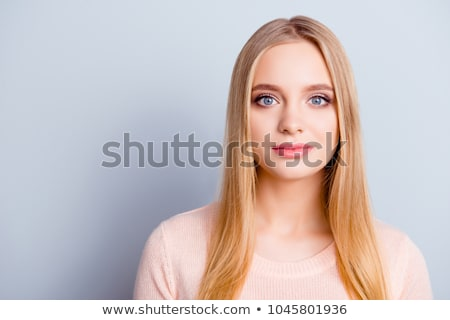 Peaceful lovely woman with long hair Isolated on gray background Stock photo © studiolucky