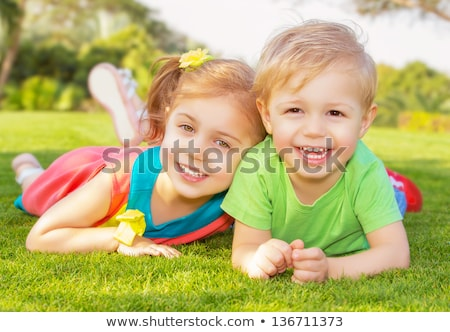 ストックフォト: Portrait Of Two Children Boy And Girl Brother In Park In Summer And Having Fun