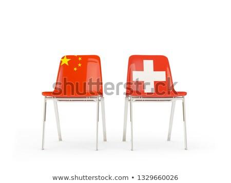 Deux chaises drapeaux Chine Suisse isolé Photo stock © MikhailMishchenko