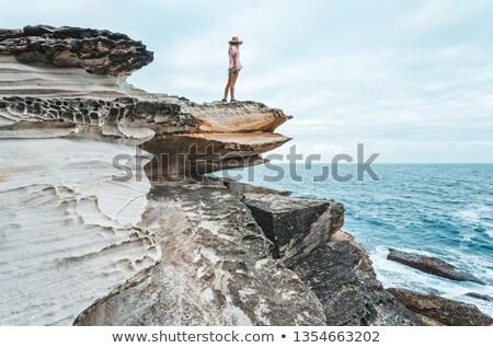 女性 海岸線 徒歩 岩 ストックフォト © lovleah