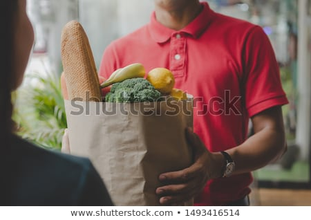 home delivery service delivers package at home and woman receivi stock photo © snowing