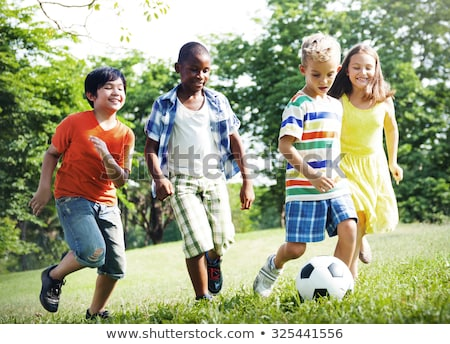 Stock photo: Multiethnic Group Of Children Playing Soccer Football Game