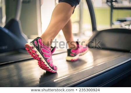 Vrouw voeten tredmolen vrouwelijke benen Stockfoto © Jasminko