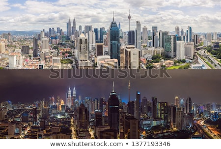 kuala lumpur skyline view of the city skyscrapers with a beautiful sky in the afternoon stock photo © galitskaya