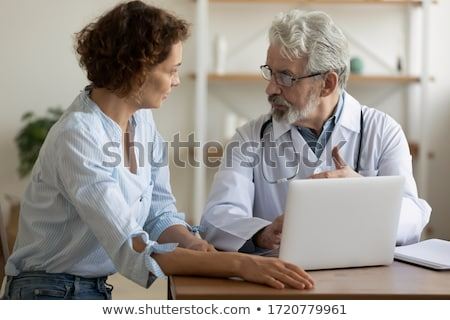 Doctor explaining for patient and showing medical records inform Stock photo © snowing