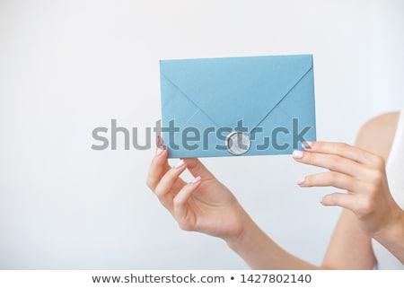 kéz · magasra · tart · felső · női · kék · szimbólum - stock fotó © vbdpua