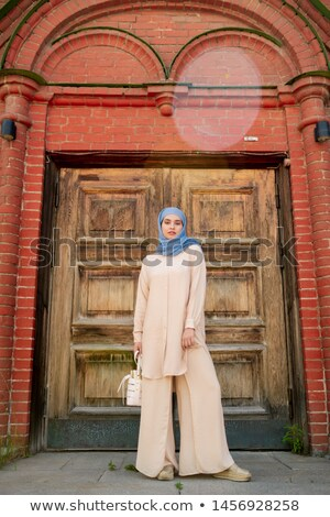 Young muslim woman in blue hijab and beige casualwear Stock photo © pressmaster