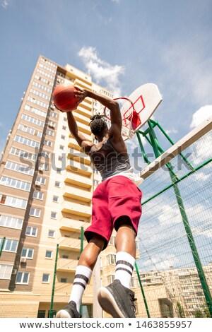 Stock fotó: Afrikai · kosárlabdázó · ugrik · labda · kosár · kék · ég