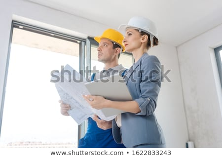 Project owner and construction worker during acceptance Stock photo © Kzenon