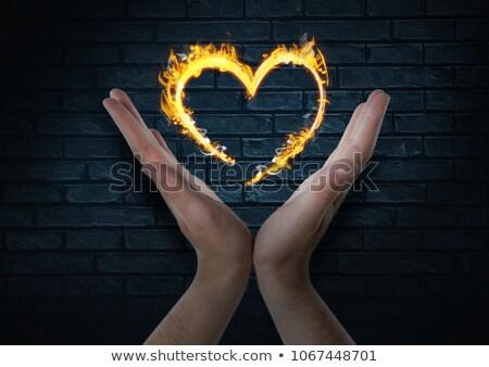 Mani cuore fuoco icona buio mattoni Foto d'archivio © wavebreak_media